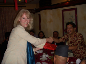 Karen Knudsen receiving a gift from Dr. Sharma, current Nepalese Ambassador to USA and President of the EWCA Kathmandu Chapter.