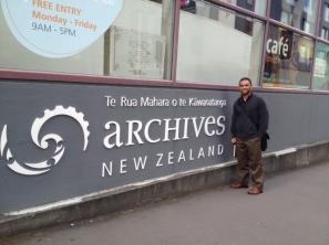 """Brian Alofaituli outside of, """"Te Rua Mahara o te Kawanatanga Archives New Zealand"""""""