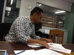 Brian Alofaituli conducting archival research.