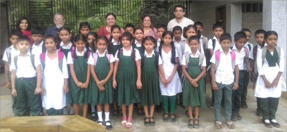 EWCA Bangladesh Chapter Alumni with children from Classes III and IV at the Ogropothik Palli Samity School