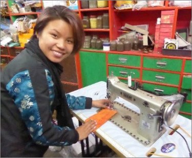 Sunu Rai with her own sewing machine purchased by the Brisbane Chapter members